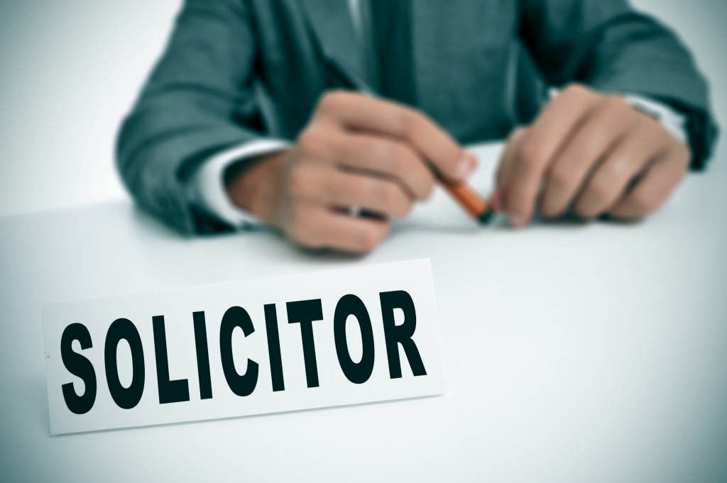 man with a solicitor nameplate