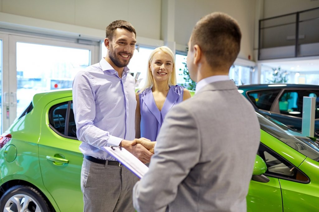 Customer shaking hands with a salesman