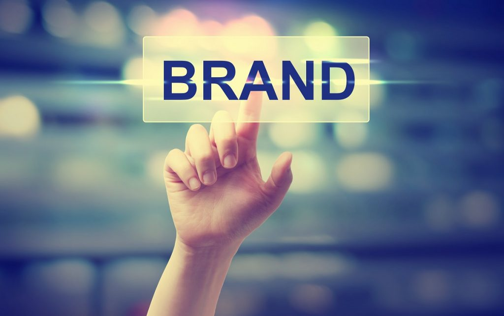 Hand pointing on the word brand
