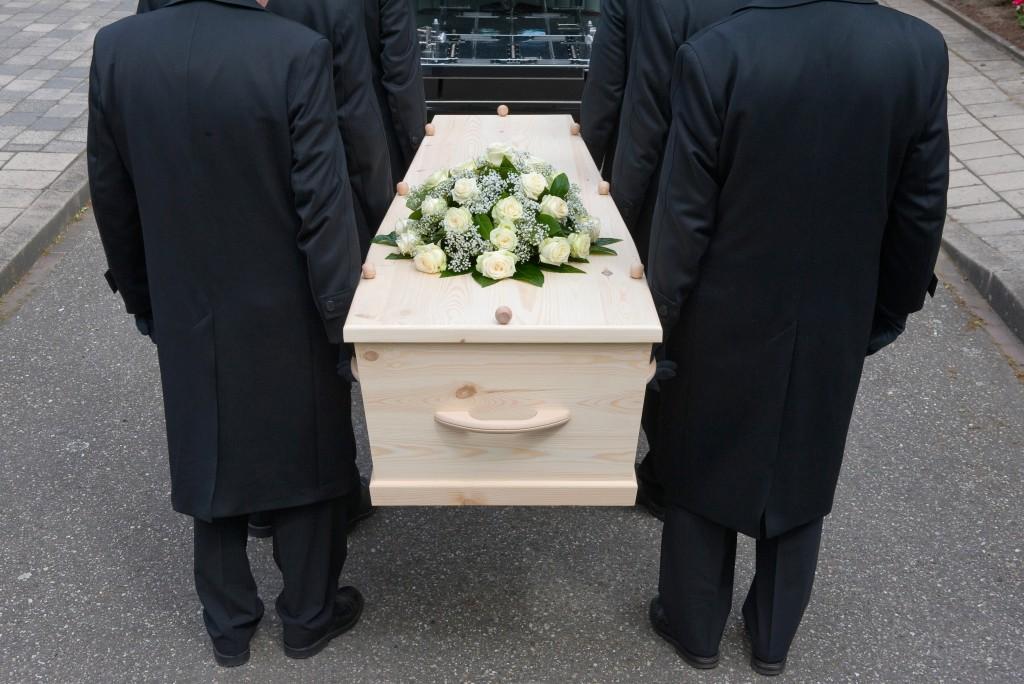 carrying a casket
