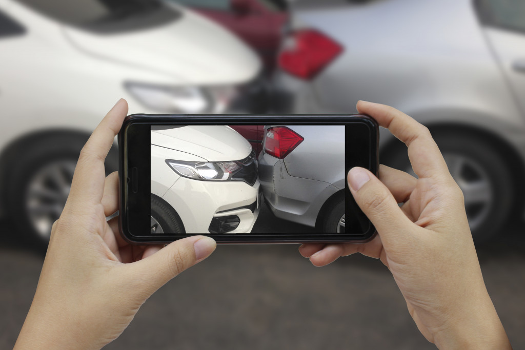 taking photo of a car accident